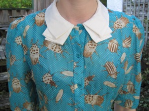 Karen Walker bug-patterned peplum blouse from The American Girl (SS12)