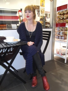 Mackenzie wears cardigan from Plume and custom-made boots by McKinlays.
