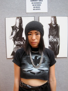 Judith from Plume wears customised NOM*d tee.