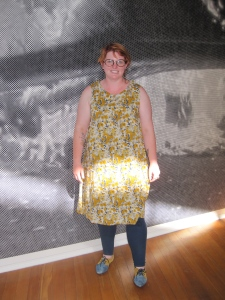 Kathryn from the Otago Polytechnic Design Department wears dress made from fabric used by Annette Cadogan for her label 'Iris'. Kathryn's lovely matching shoes were bought on TradeMe.