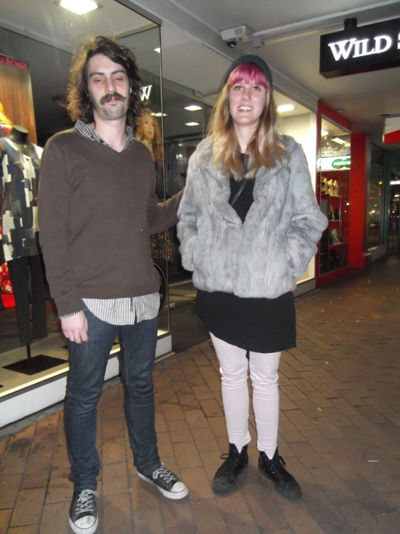 Tom and Aimee. Aimee wears fur coat from Butterflies.
