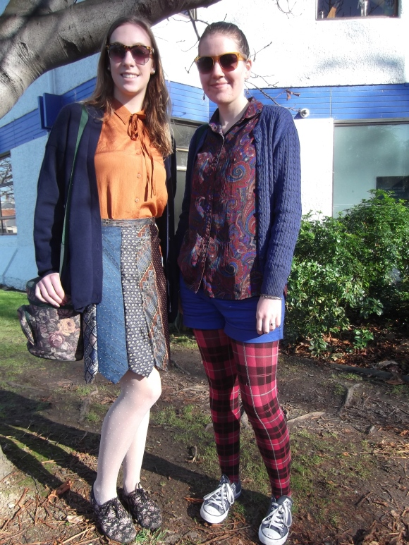 Jenny and Hannah. Jenny wears orange blouse from Toffs and skirt made by herself from op-shop ties. Hannah wears cardigan from Toffs and op-shop items.