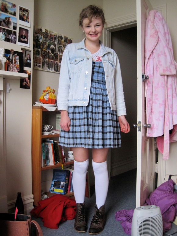 Abby wears a pinafore dress from Belle Bird, jacket bought online and shoes from Wild Pair.