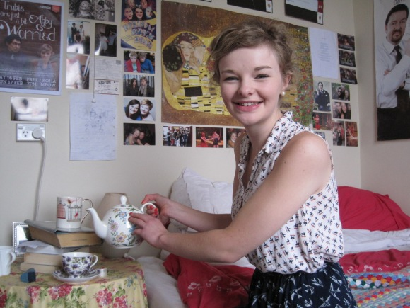 Tea time: Abby certainly knows how to match prints. Her horse print shirt from Wales is teamed with a bird print skirt.