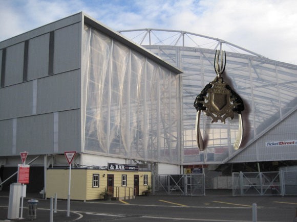 Company of Strangers Protection necklace hangs around the Forsyth Barr Stadium, Dunedin.