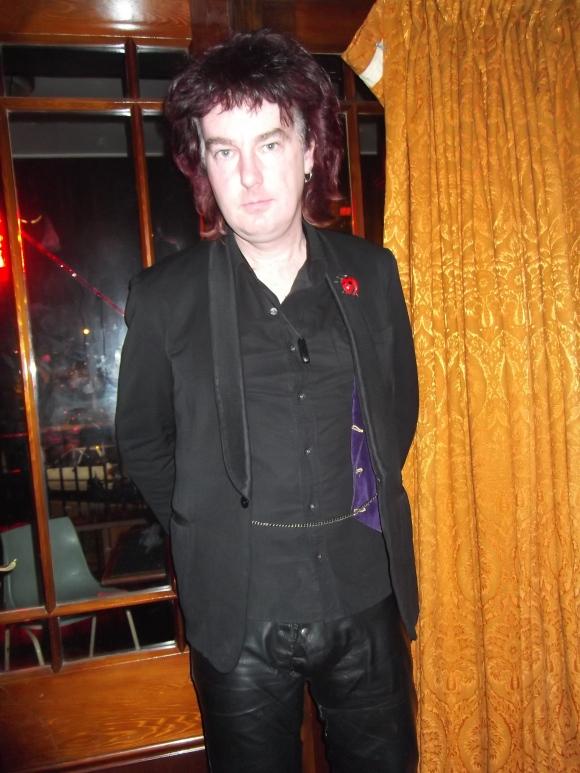Michael wears op-shop jacket, vintage pants and purple waistcoat made by himself.