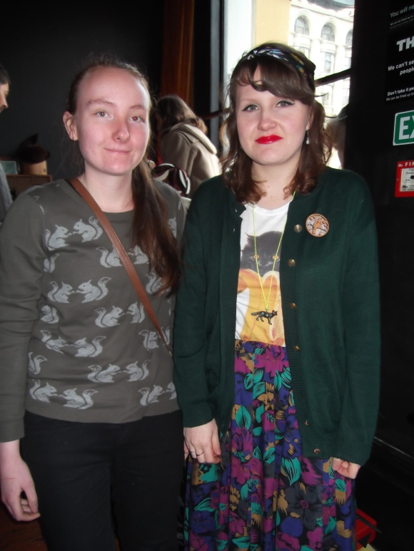 Becky and Christina. Becky wears high street. Christina wears vintage op-shop skirt from Dunedin and retro brooch from Christchurch.