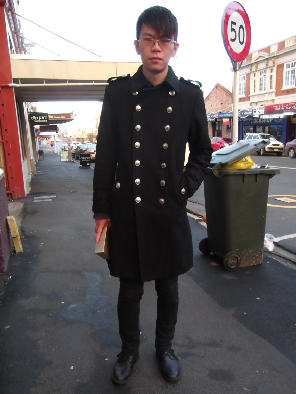 Jack wears military coat from overseas.