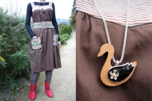 Vintage pinafore and belt from The Modern Miss. Duck pendant from The Clothing Port, Port Chalmers. Worn with leggings from Glassons and gumboots by Vivienne Westwood for Melissa from Belle Bird.