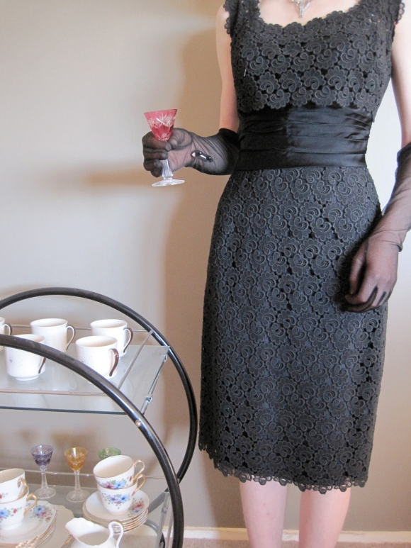 Lace cocktail dress worn with gloves from Shop on Carroll. Tea set from Butterflies Hospice Shop.