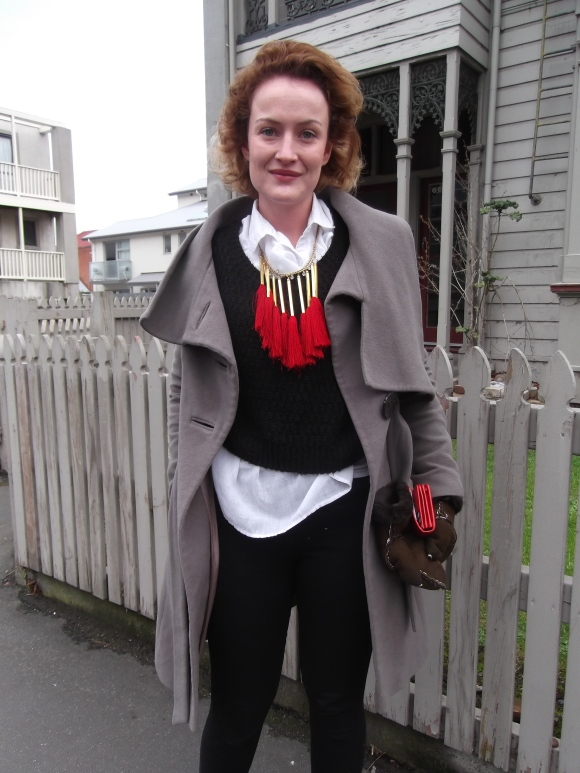 Holly (from England) wears necklace by Vivienne Westwood from the V&A, coat by Karen Millen and jeans by Storm.