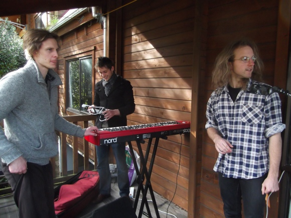 Setting up on the porch with the help of Michael Morris (right)