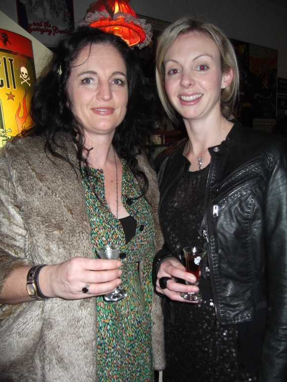 Sharon and Sanae. Sharon wears dress from the Vintage Dress Company. Sanae wears dress by Charmaine Reveley.