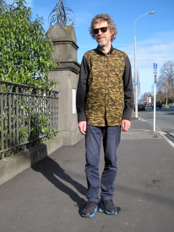 Dorian wears shirt by Moodie Tuesday and pants by Barkers.