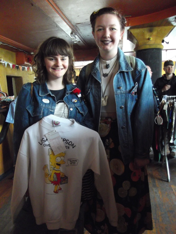 Rosie and Jordan show off a top from Kings Emporium. Rosie wears denim jacket from the old Recycle Boutique. Jordan wears clothes from South Dunedin op shops.