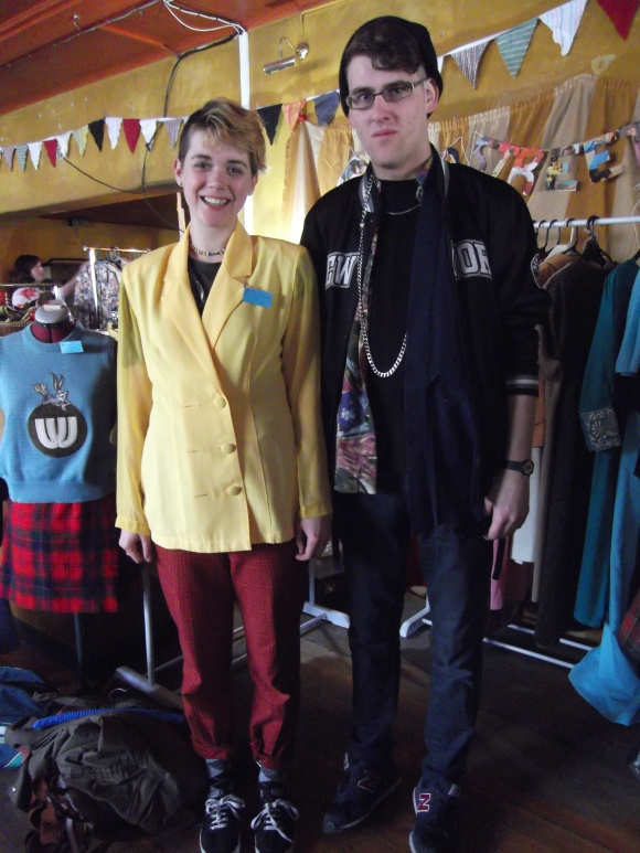 Rosa and Zac. Rosa wears blazer from Brown Street Bespoke. Zac wears clothes from Toffs and a Jewish good luck charm.