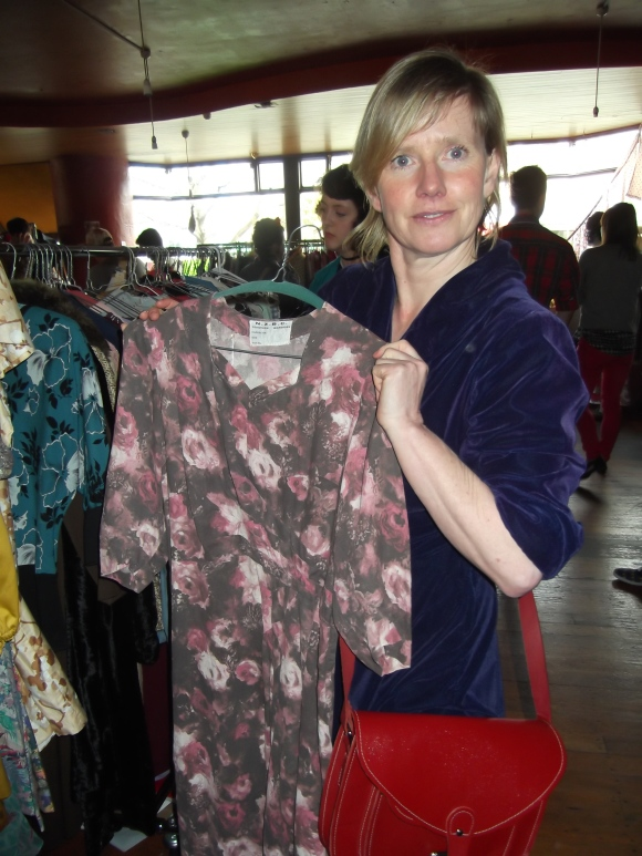 Sharon displays a vintage dress from the Bonham Theatre.