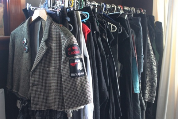Rack with jacket featuring NOM*d patches.