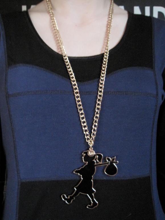 Karen Walker Runaway Girl pendant ($35) – Belle Bird Boutique (327 George Street). Worn with dress by NOM*d.