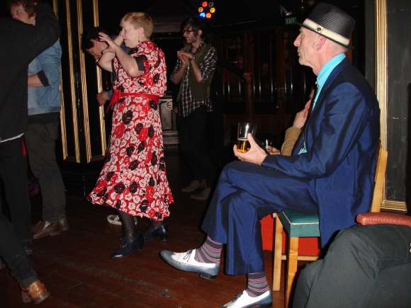 Debbie owns the dance floor while the dapper Frits looks on