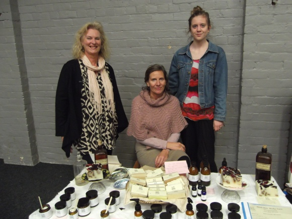 From left: Janie, Penelope and daughter Sarah. Penelope and Sarah display their 'Real Skin' products