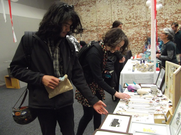 Jon and Clare browse for goodies at 'Sparrow and the Wolf Boy' stall