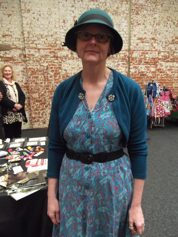 Simone wears dress from Shop on Carroll, cardigan from Toffs, hat from Farmers and chain from Oamaru Hospice Shop.