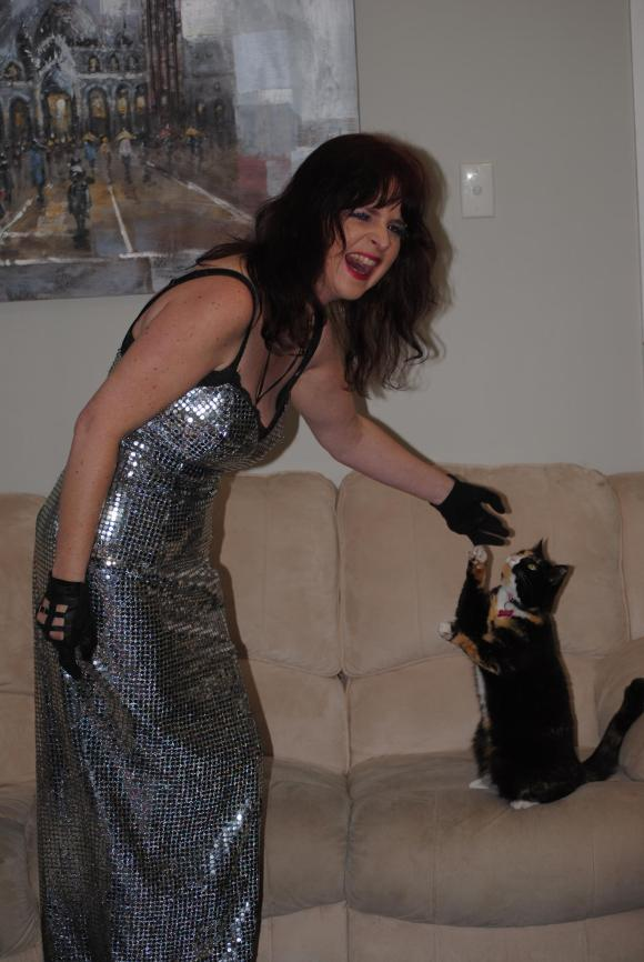 Musician and cat whisperer, Mary, with her beautiful tortie Miss Noisy. Photo provided by Mary.