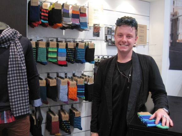 Sam Ralph with his own sock designs in Barkers, Dunedin (March 2013)