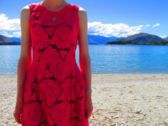 Charmaine Reveley 'Heartest of Hearts' dress brightens up Lake Wanaka. Necklace by Underground Sundae.
