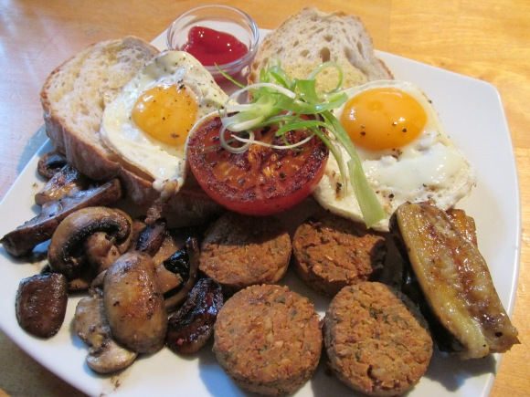 Eggs on toast with falafel, mushrooms, tomato and grilled banana at Walnut Cottage