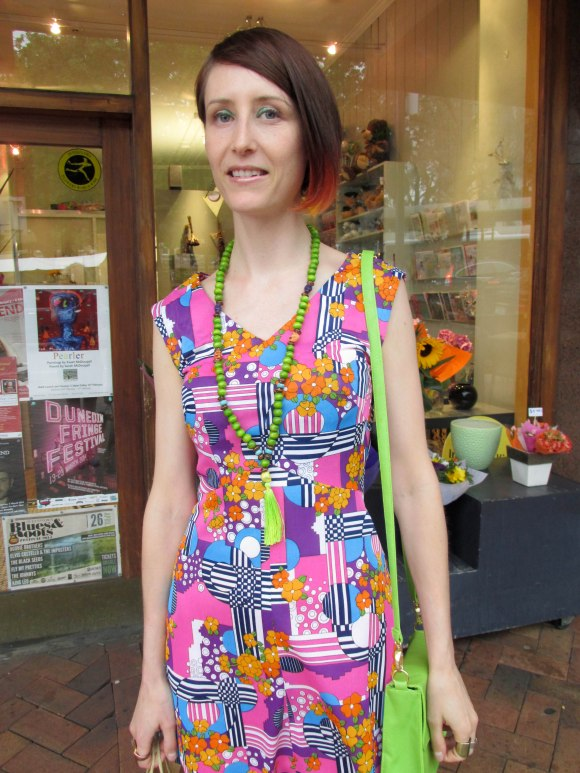 Tannia wears dress from Most Wanted Vintage and necklace from Thieves Alley Market.