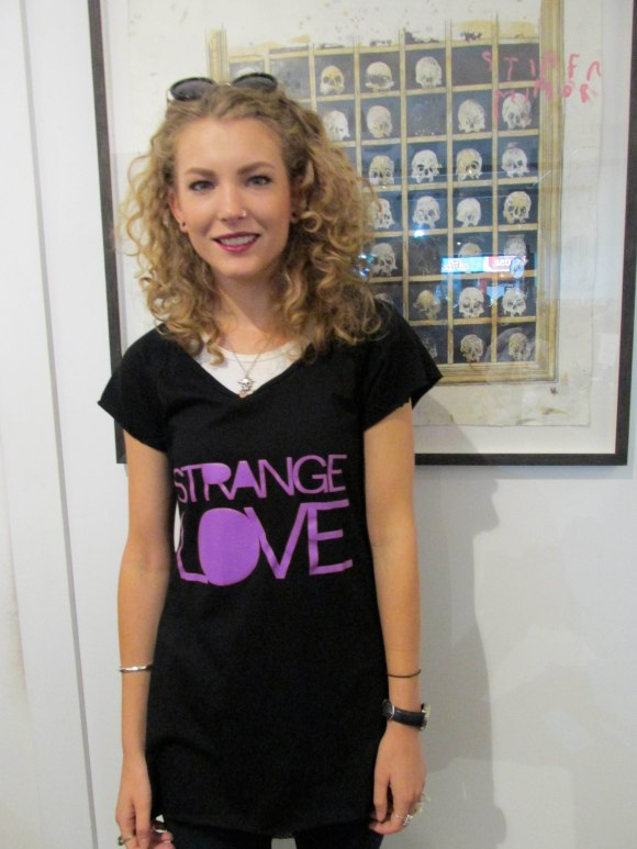 Izzy tries on Strange Love top