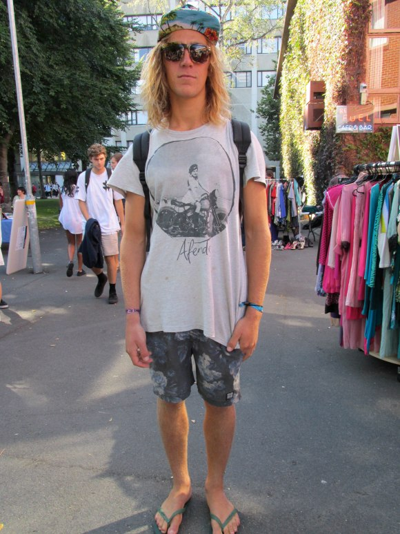 Austin wears t-shirt and shorts from overseas and hat from OUSA market.
