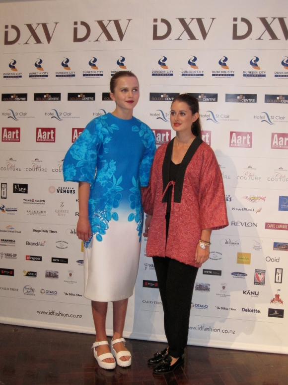 Lucilla Gray (right) with a piece from her 'Hyper-Floralis' collection. Lucilla won the NZ Light Leathers award.