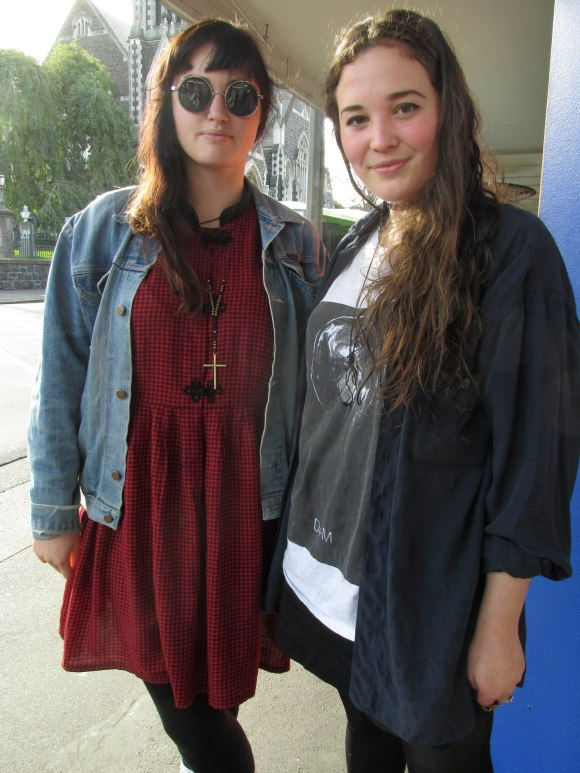 Hannah and Rosie. Hannah wears vintage dress from Wellington and denim jacket gifted to her by Rosie. Rosie wears a 'Death and the Maiden' tee and shirt from Toffs.