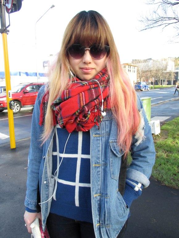 Kayla wears jacket and jumper from Hong Kong.