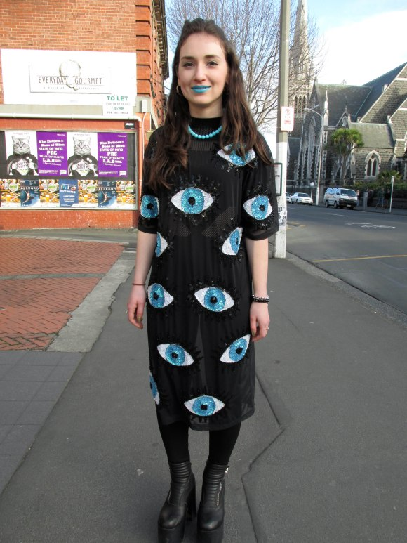 Stephanie wears dress by Di$count Univer$e, op-shop necklace and boots by Unif. Her lipstick is 'No She Didn't' blue by Lime Crime.