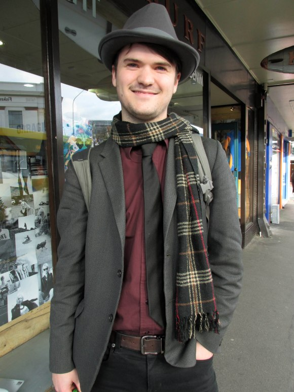 Iain wears tie by Barkers, shirt by Hallensteins, jacket from his dad, scarf he found on the street and hat from Arthur Barnett. Iain writes a stand-up poetry blog called 'The Ink Jester'.