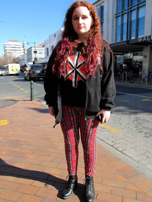 Laura wears t-shirt from Disk Den, pants from Dotti and boots from Number One Shoes.