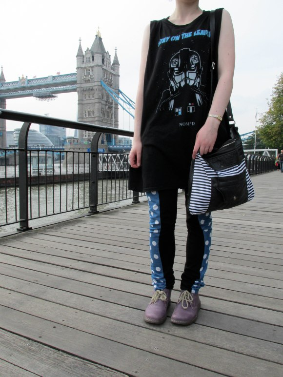 'Tie Fighter' singlet from NO*SENSE by NOM*d worn with pants and bag by Company of Strangers
