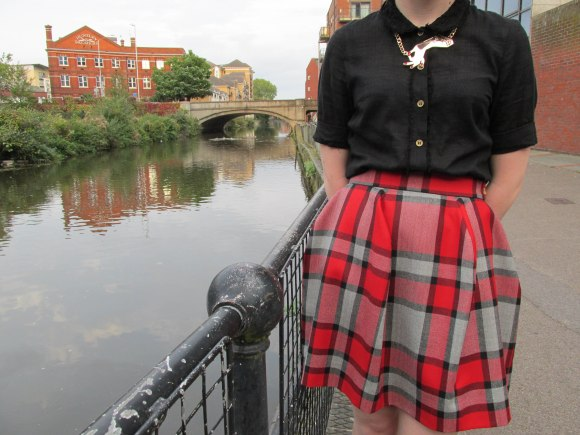 Skirt by Vivienne Westwood worn with shirt by Kate Sylvester and necklace by Karen Walker