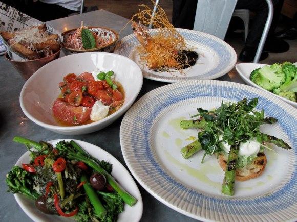 Clockwise from top: Crispy King Prawns, Grilled Asparagus Bruschetta, Baby Italian Broccoli, Heritage Tomato Salad, Posh Chips, Crunchy Veg Salad.