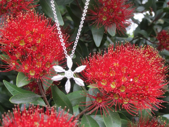 Snow feather necklace designed by Boh Runga, made by NZ Mint