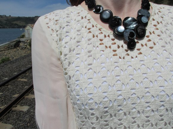 Button necklace worn with dress by Charmaine Reveley