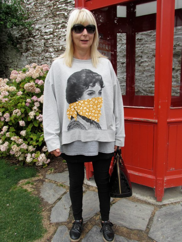 Lynne wears sweatshirt by Karen Walker