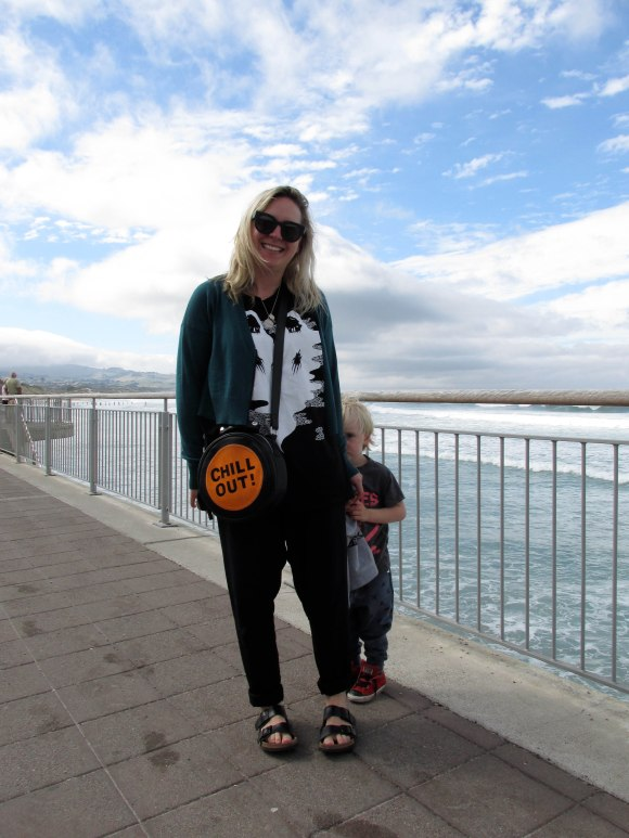 Sara wears top by Strangelove x Zac Fay and bag by Emma Mulholland.