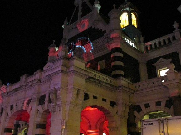 Poppy images on Dunedin Railway Station in honour of the 100th anniversary of Gallipoli